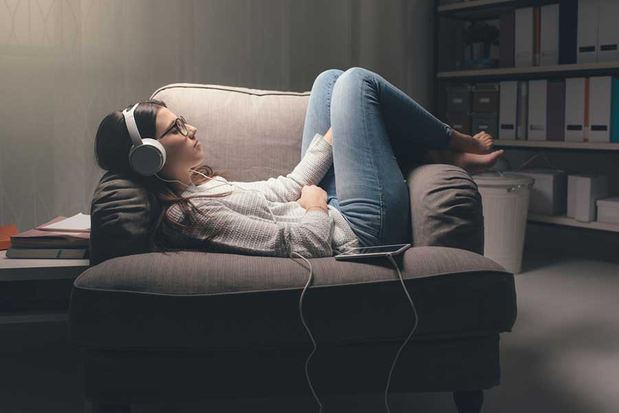 Teenager relaxing with music