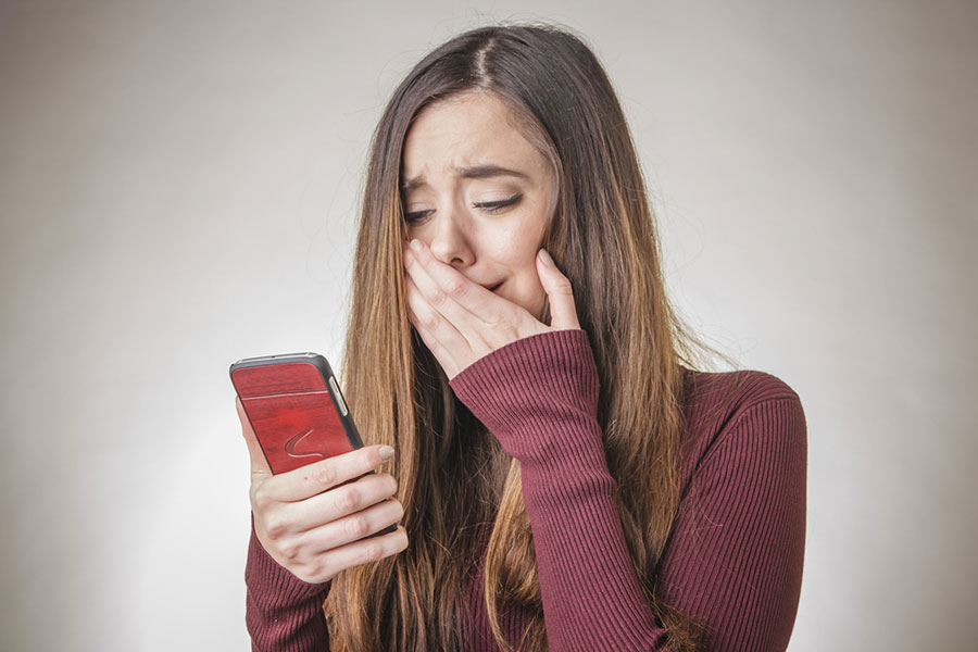Teenager crying over friendship on phone