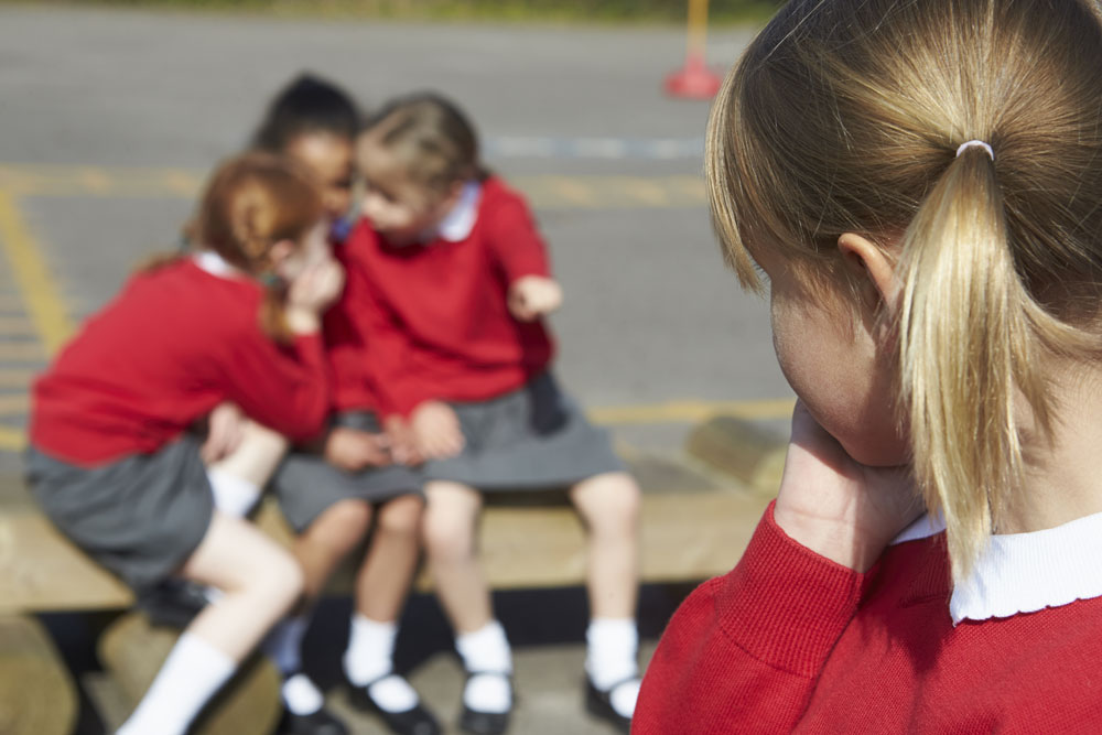 Young girls bullying on playground