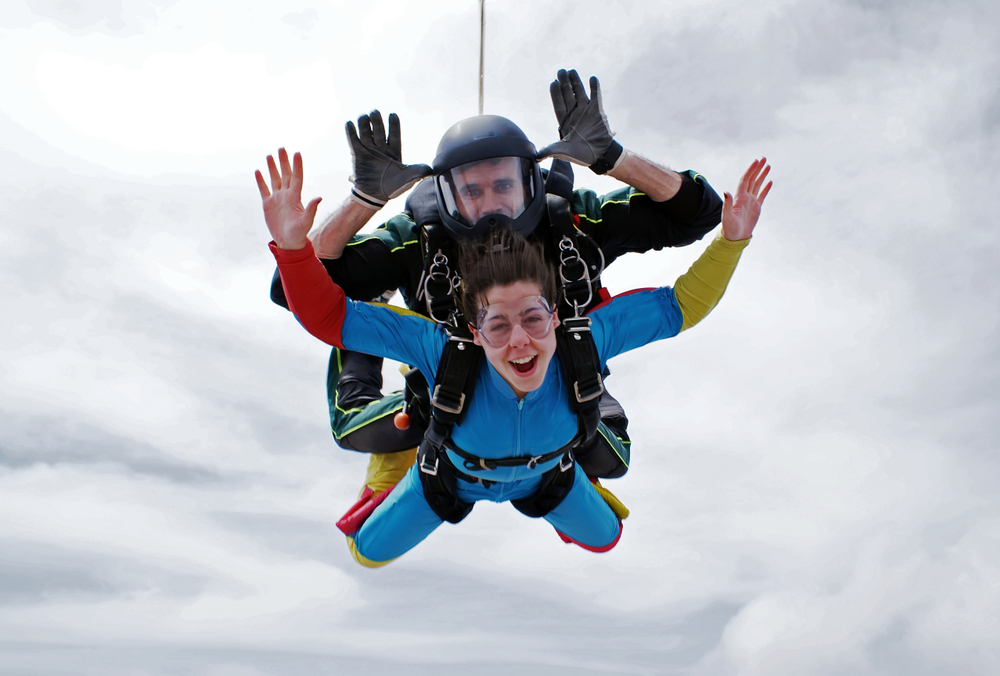 2 teenagers doing a sky dive