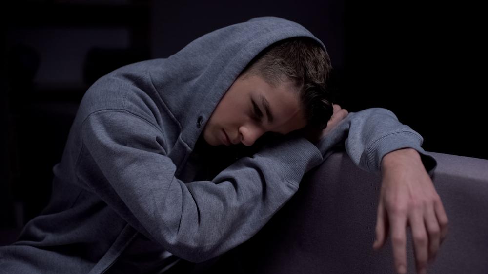 Teenager slumped over upset