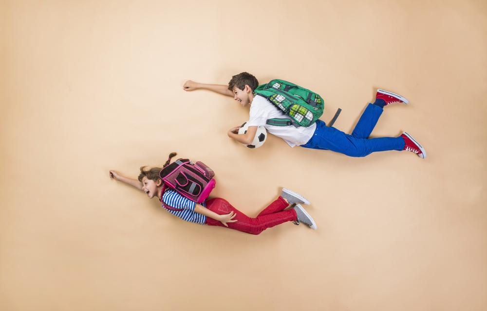 Two children flying away