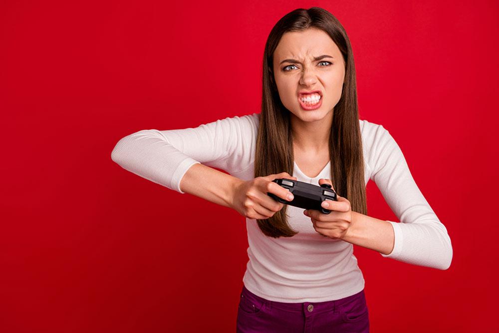 Angry teenage girl who is addicted to gaming