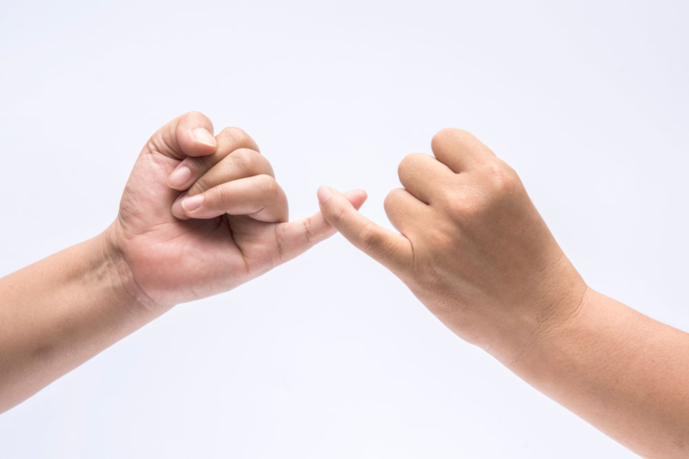 Two hands in the pinky promises lock
