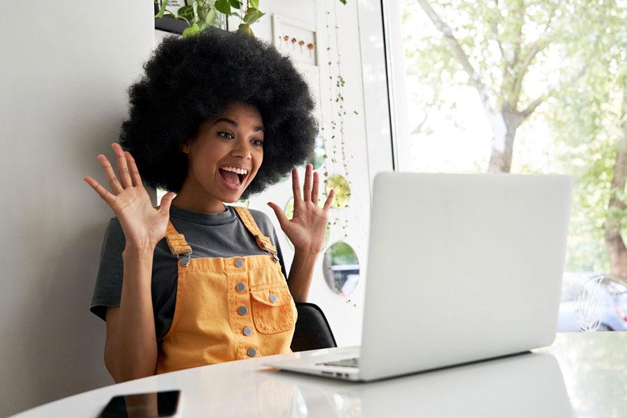 Woman facing computer images