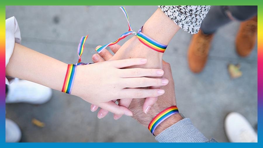 LGBT hands on hands all with LGBT Bracelets
