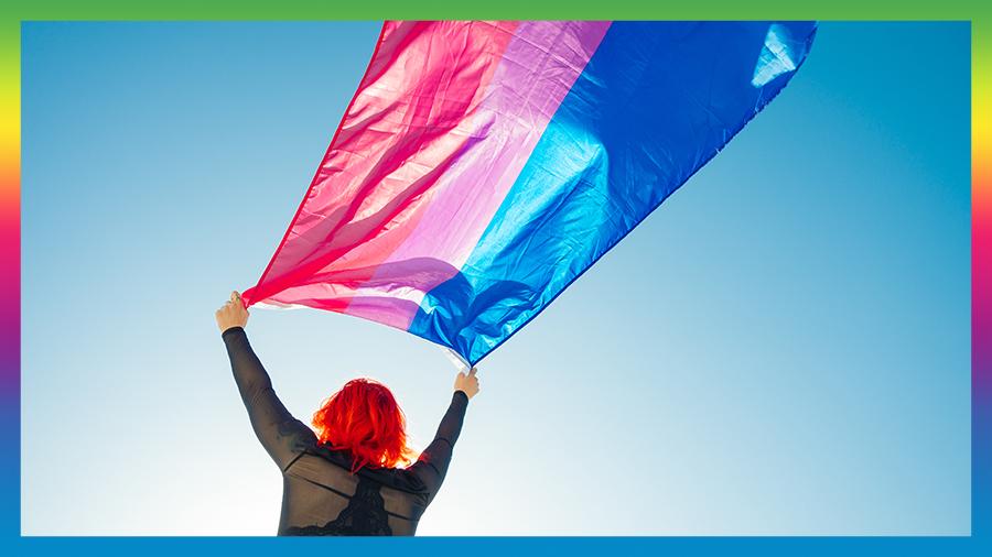 Woman flies the bi-sexual flag in the air